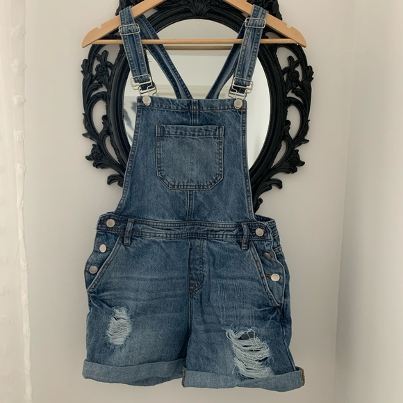 Distressed overall jean shorts